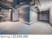 Купить «Basement with corridor, storage room, cwire channels, pipes», фото № 25838280, снято 30 марта 2016 г. (c) Losevsky Pavel / Фотобанк Лори