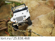 Купить «MOSCOW, RUSSIA - APR 02, 2016: Toy model of car has an accident on mountain rocky road in recreational zone Arena of Aviapark shopping center. Aviapark shopping area - 230 000 sq.m.», фото № 25838468, снято 2 апреля 2016 г. (c) Losevsky Pavel / Фотобанк Лори