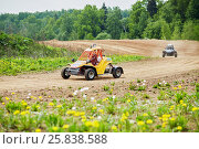 Купить «MYTISHCHI, RUSSIA - MAY 24, 2015: Two children on the racing cars compete on the track with a dirt road», фото № 25838588, снято 24 мая 2015 г. (c) Losevsky Pavel / Фотобанк Лори