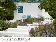 Купить «Steps with flowers at sides leading to wall with window, pillows and big flowerpot at summer park», фото № 25838604, снято 26 июня 2015 г. (c) Losevsky Pavel / Фотобанк Лори