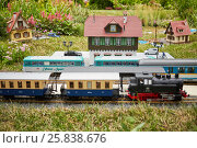 Купить «MOSCOW, RUSSIA - JUN 26, 2015: Layout of old railway station with rails, trains and buildings in Sokolniki park during festival Gardens and People», фото № 25838676, снято 26 июня 2015 г. (c) Losevsky Pavel / Фотобанк Лори