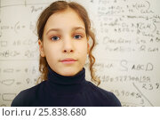 Купить «Schoolgirl stands near blackboard with many mathematics formulas in classroom, text - Formula, answer», фото № 25838680, снято 7 апреля 2016 г. (c) Losevsky Pavel / Фотобанк Лори