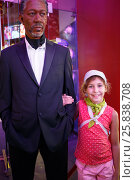 Купить «NEW YORK - August 22, 2014: girl (with model release) with a wax figure of Morgan Freeman», фото № 25838708, снято 22 августа 2014 г. (c) Losevsky Pavel / Фотобанк Лори