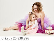 Купить «Mother and little daughter sit together on the floor near two-story dish with marshmallows», фото № 25838896, снято 29 марта 2015 г. (c) Losevsky Pavel / Фотобанк Лори