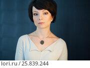 Купить «Shoulder portrait of dark-haired woman in white knitted dress», фото № 25839244, снято 29 марта 2015 г. (c) Losevsky Pavel / Фотобанк Лори