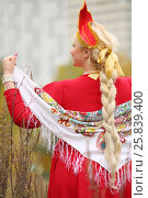 Купить «Woman in traditional russian kokoshnik with kerchief, long braid poses outdoor, back view», фото № 25839400, снято 15 октября 2015 г. (c) Losevsky Pavel / Фотобанк Лори