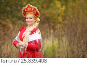 Купить «Woman in traditional russian kokoshnik with kerchief, braid poses outdoor», фото № 25839408, снято 15 октября 2015 г. (c) Losevsky Pavel / Фотобанк Лори
