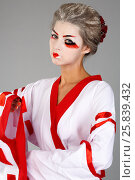 Купить «Girl in traditional Japanese costume and makeup standing with hand raised studio shot», фото № 25839432, снято 17 ноября 2014 г. (c) Losevsky Pavel / Фотобанк Лори