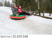 Woman with child rolling hills on a sledge in the forest. Стоковое фото, фотограф Losevsky Pavel / Фотобанк Лори