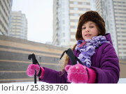 Купить «Portrait of a young girl in a winter hat with ski poles near the blocks of flats», фото № 25839760, снято 5 января 2015 г. (c) Losevsky Pavel / Фотобанк Лори