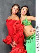 Купить «Two beautiful women in a green and red costumes», фото № 25839764, снято 22 ноября 2014 г. (c) Losevsky Pavel / Фотобанк Лори