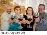 Купить «Happy two men and two women held out their glasses of red wine», фото № 25839908, снято 22 февраля 2015 г. (c) Losevsky Pavel / Фотобанк Лори