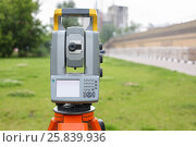 Купить «Measuring instrument for topographic and geodetic shooting in front of green grass and buildings», фото № 25839936, снято 7 июля 2015 г. (c) Losevsky Pavel / Фотобанк Лори