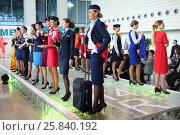 Купить «MOSCOW – JUL 09, 2015: Beautiful women shows a uniforms flight attendant at a special screening of uniforms airlines DME RUNVAY in Domodedovo», фото № 25840192, снято 9 июля 2015 г. (c) Losevsky Pavel / Фотобанк Лори