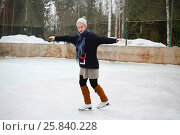 Купить «Young girl in a knitted sweater skating on a skating rink», фото № 25840228, снято 23 февраля 2015 г. (c) Losevsky Pavel / Фотобанк Лори