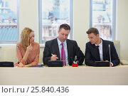Купить «Businessmen and woman hold a meeting in the conference room», фото № 25840436, снято 10 апреля 2014 г. (c) Losevsky Pavel / Фотобанк Лори