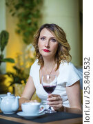 Купить «Middle-aged woman in white dress sits with red wine in cozy restaurant», фото № 25840532, снято 12 июля 2015 г. (c) Losevsky Pavel / Фотобанк Лори