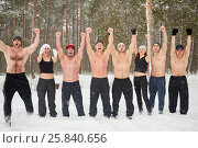 Купить «Eight young people jump, shout and wave with hands on the edge of snowy winter wood», фото № 25840656, снято 11 января 2015 г. (c) Losevsky Pavel / Фотобанк Лори