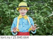 Купить «Half-length portrait of little boy in dance suit pulling off braces with thumbs», фото № 25840664, снято 29 мая 2016 г. (c) Losevsky Pavel / Фотобанк Лори