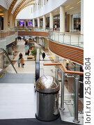 Купить «Modern big shopping center with two floors, escalator, trashcan in foreground», фото № 25840804, снято 21 апреля 2015 г. (c) Losevsky Pavel / Фотобанк Лори