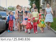 Купить «Group of eleven children and four woman walks down street», фото № 25840836, снято 29 мая 2016 г. (c) Losevsky Pavel / Фотобанк Лори