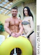 Купить «Portrait of a tanned man and light-skinned woman with big yellow swimming circle at the aquapark», фото № 25840888, снято 28 февраля 2015 г. (c) Losevsky Pavel / Фотобанк Лори