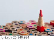Купить «Red sharpened pencil among colorful crayons», фото № 25840984, снято 19 марта 2017 г. (c) Pavel Biryukov / Фотобанк Лори