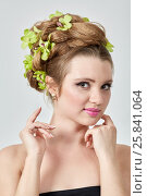 Купить «Portrait of young woman with hairdress with green petals braided», фото № 25841064, снято 11 января 2015 г. (c) Losevsky Pavel / Фотобанк Лори