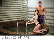 Купить «Portrait of a tanned man and light-skinned woman near round pool in sauna», фото № 25841148, снято 28 февраля 2015 г. (c) Losevsky Pavel / Фотобанк Лори