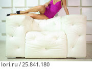 Купить «Pretty woman in bodysuit and shoes with heels posing on armchair, noface», фото № 25841180, снято 4 июня 2015 г. (c) Losevsky Pavel / Фотобанк Лори