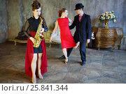 Купить «Couple dancing tango near girl playing saxophone. Pair out of focus», фото № 25841344, снято 4 июня 2015 г. (c) Losevsky Pavel / Фотобанк Лори