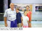 Купить «A woman and elderly man with boy and girl in the vestibule of the hotel», фото № 25841408, снято 27 июля 2014 г. (c) Losevsky Pavel / Фотобанк Лори