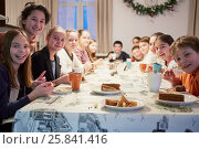 Group of thirteen children sits at table during tea party. Стоковое фото, фотограф Losevsky Pavel / Фотобанк Лори