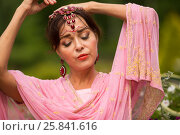 Купить «Middle age woman in pink sari and Indian adornment poses in summer park», фото № 25841616, снято 19 июля 2015 г. (c) Losevsky Pavel / Фотобанк Лори