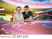 Купить «Young man and woman in retro dress at the bar near pink car», фото № 25841624, снято 18 января 2015 г. (c) Losevsky Pavel / Фотобанк Лори