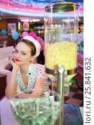 Купить «Young woman in retro dress sitting in bar with snacks», фото № 25841632, снято 18 января 2015 г. (c) Losevsky Pavel / Фотобанк Лори