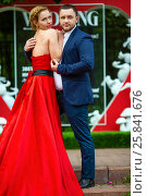 Купить «Man in suit and woman in red dress pose near wall with heart and text Wedding», фото № 25841676, снято 19 июля 2015 г. (c) Losevsky Pavel / Фотобанк Лори