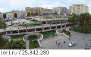 Купить «MOSCOW - AUG 12, 2014: Manezhnaya Square with beautiful fountains and the shopping center Okhotny Ryad, aerial view», фото № 25842280, снято 12 августа 2014 г. (c) Losevsky Pavel / Фотобанк Лори