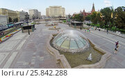 Купить «MOSCOW - AUG 12, 2014: Fountains on Manezh Square, aerial view. View of the Moscow hotel», фото № 25842288, снято 12 августа 2014 г. (c) Losevsky Pavel / Фотобанк Лори