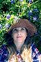 Портрет голубоглазой девушки блондинки в шляпе лежащей в  синих люпинах, фото № 25845236, снято 23 марта 2017 г. (c) Ирина Кожемякина / Фотобанк Лори