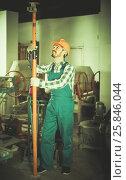 Купить «working man practicing his skills erect trestle at workshop», фото № 25846044, снято 17 января 2017 г. (c) Яков Филимонов / Фотобанк Лори