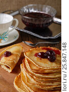 Still life of pancakes, cherry jam and a cup. Стоковое фото, фотограф Леонид Якутин / Фотобанк Лори