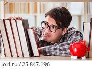 Купить «Young student in expensive textbooks concept», фото № 25847196, снято 6 февраля 2017 г. (c) Elnur / Фотобанк Лори