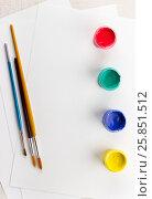 Купить «Accessories to drawing: paper, paints, brushes. Top view», фото № 25851512, снято 15 сентября 2015 г. (c) Надежда Рыбальченко / Фотобанк Лори