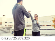 Купить «woman with trainer working out self defense strike», фото № 25859320, снято 17 октября 2015 г. (c) Syda Productions / Фотобанк Лори