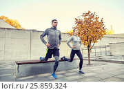 Купить «couple doing lunge exercise on city street», фото № 25859324, снято 17 октября 2015 г. (c) Syda Productions / Фотобанк Лори