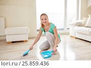 Купить «happy woman with brush and dustpan sweeping floor», фото № 25859436, снято 25 января 2015 г. (c) Syda Productions / Фотобанк Лори