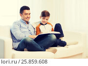 Купить «happy father and son reading book at home», фото № 25859608, снято 24 октября 2015 г. (c) Syda Productions / Фотобанк Лори