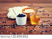 Купить «close up of coffee scrub in cup and honey on wood», фото № 25859652, снято 21 декабря 2015 г. (c) Syda Productions / Фотобанк Лори