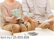 Купить «senior couple with money and calculator at home», фото № 25859808, снято 4 сентября 2014 г. (c) Syda Productions / Фотобанк Лори